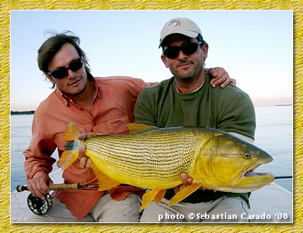 ramiro badessich and pinti fishing for dorado on the upper paraná river at repesqui